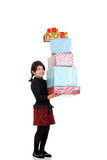 Girl carrying huge pile of christmas presents Royalty Free Stock Photos