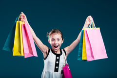 Girl carrying lots of shopping bags Royalty Free Stock Image