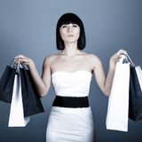 girl carrying new bags Stock Photography
