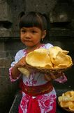 Girl carrying Prawn crackers Royalty Free Stock Image