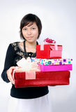 Girl carrying presents Stock Photo