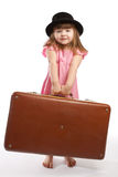 Girl carrying suitcase Royalty Free Stock Photos