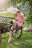 Girl on cart royalty free stock image