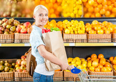 Girl with cart hands paper bag Royalty Free Stock Photo
