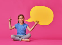 Girl with cartoon speech. Cute little child girl with cartoon speech on colorful background. Yellow, pink and blue colors Royalty Free Stock Images