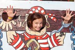 Girl in cartoon stocks. Funny girl posing and waving hands in cartoon stocks royalty free stock photography