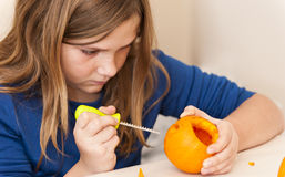 Girl Carving Pumpkin Stock Photos