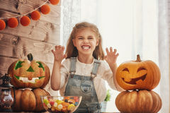Girl with carving pumpkin Royalty Free Stock Photography