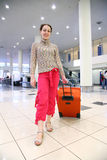 Girl with case. At the airport royalty free stock photography