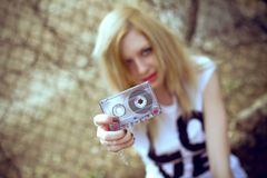 Girl with a cassette in hand Royalty Free Stock Photo