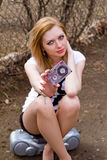 Girl with a cassette and tape recorder outdoors Stock Photos