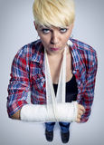 Girl with cast on her arm stock photos