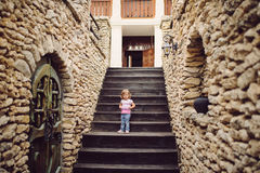 Girl on Castle Stairs Royalty Free Stock Photos