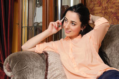 Girl in casual clothes talking on the phone Royalty Free Stock Photography