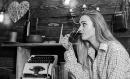 Girl in casual outfit sits in wooden vintage interior. Girl tomboy relax with glass with mulled wine in house of. Gamekeeper. Lady on dreamy face in plaid royalty free stock photo