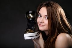 Girl with casual shoe. Women loves shoes concept. Stock Photos