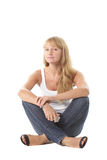 Girl in casual sitting on white stock photography