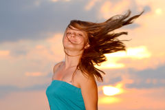 Girl with casual style wear against sunset sky Royalty Free Stock Image