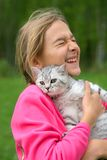 Girl with cat. Smiling girl with british cat Royalty Free Stock Photo