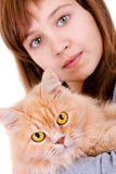 Girl with a cat. Beautiful teen girl holding her cat on a white background royalty free stock photos