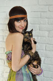 Girl with a cat. Beautiful girl holding a cat Stock Images