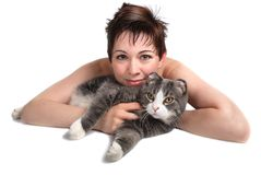 Girl and cat. Pretty girl laying down cuddling her pet cat Royalty Free Stock Image