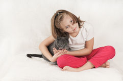 Girl and a cat stock photo