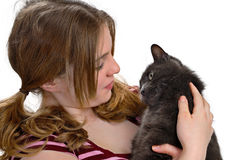 Girl with cat. Gray cat looking adoringly at girl while being held Stock Images