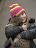 The girl and a cat. The girl holds on hands of a cat Royalty Free Stock Photography