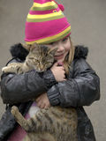 Girl with cat. A pretty young blonde girl holds a calico cat Stock Photography