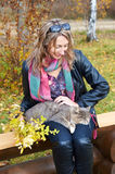 A Girl and a Cat in the Autumn Park Royalty Free Stock Image