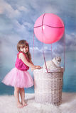 Girl and cat with balloon Royalty Free Stock Photo