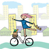 Girl with a cat on a bicycle. Royalty Free Stock Photography