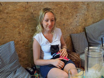 Girl in cat cafe Stock Photography