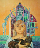 Girl with a cat. And a castle Stock Images
