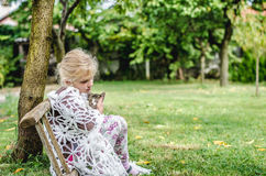 Girl with cat in the garden Royalty Free Stock Photos