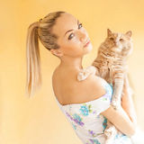 Girl with a cat in her arms Stock Photo