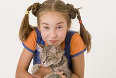 Girl with a cat IV. The nice girl with a grey cat Royalty Free Stock Photography