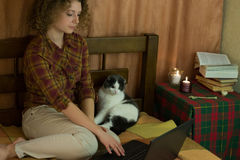 Girl with cat and laptop Royalty Free Stock Photo