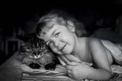 The girl and the cat. mutual understanding. no coffee wakes up in the morning royalty free stock photography