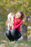 Girl with cat on natural background Royalty Free Stock Image