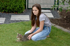 Girl and cat playing Royalty Free Stock Photo