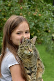 Girl and cat playing Royalty Free Stock Images