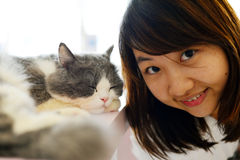 Girl with cat Stock Image