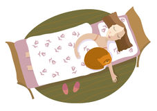 The girl and a cat sleep on a bed Royalty Free Stock Image