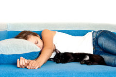 Girl and a cat sleeping next to similar positions Royalty Free Stock Photo