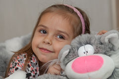 Girl with cat soft toy. Little girl embracing cat soft toy Stock Photography