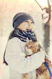 Girl and cat Stock Photos