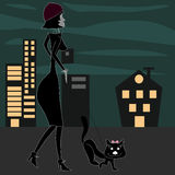 Girl with cat walking  in the city at night. Stock Image