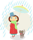 Girl with a cat walking under an umbrella in the r Stock Photo